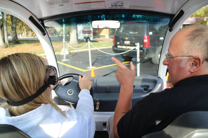 Instructor with Teen doing a drunk driving simulation