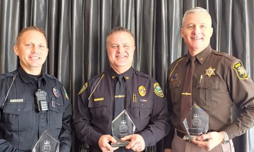 3 officers from the ALI coalition posing with awards for an event