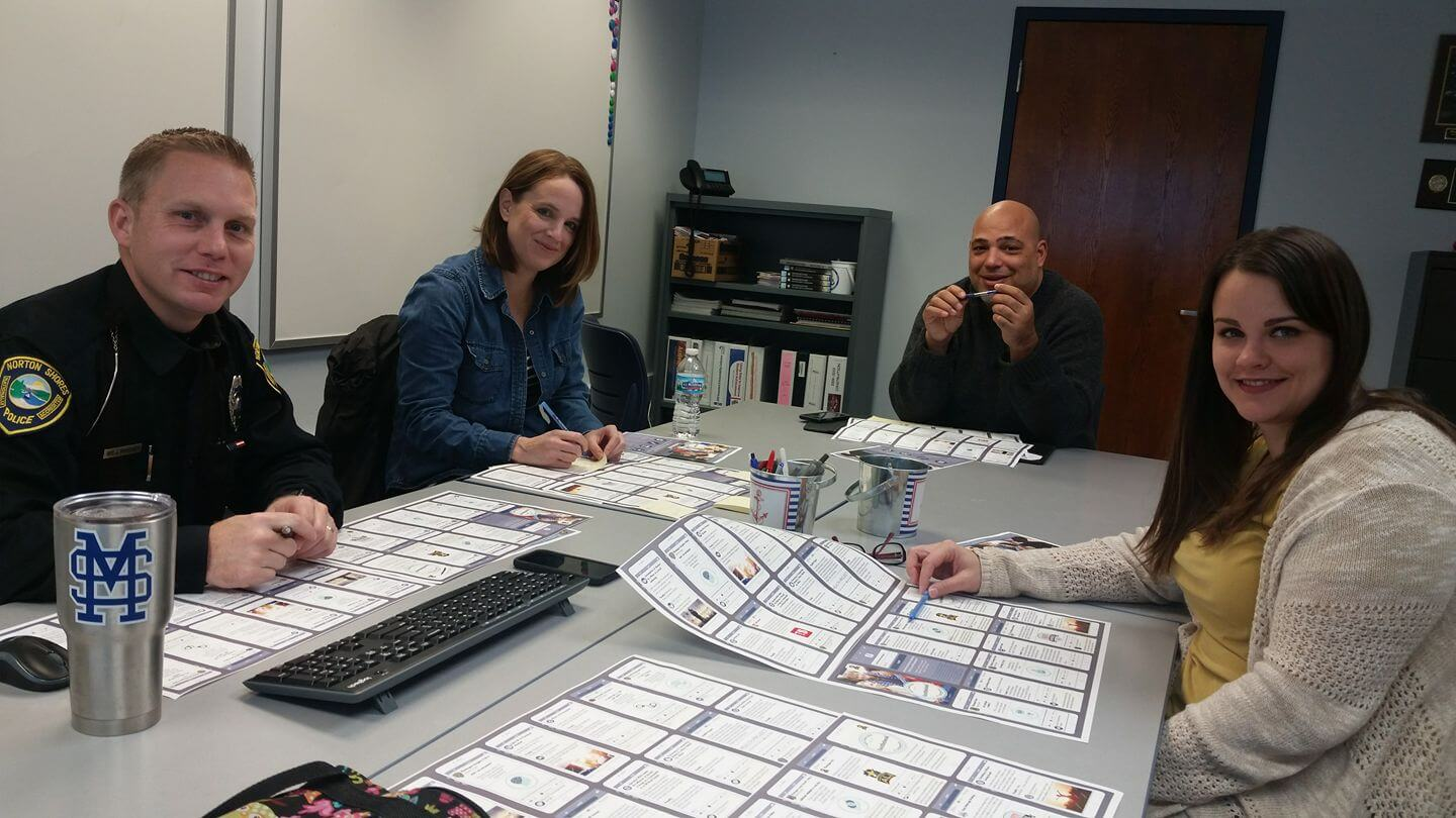 Coalition Members Reviewing The FaceTheBook Brochure