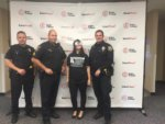 Binge Effects Event With Teenage Girl Posing With Officers For The Alcohol Liability Initiative Coalition